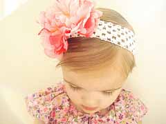 Girl with a head band and a hair bow