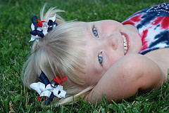 Blond girl with pigtails and corker hair bows