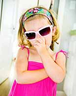 Blond girl with sun glasses and head band