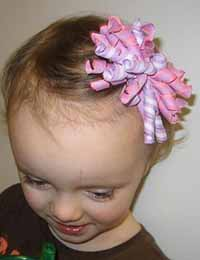 Girl with a pink corker hair bow