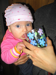 Baby drinks from normal cup