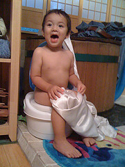 Boy sitting on a white potty