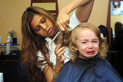 First haircut toddler girl crying