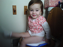 Girl sitting on a potty