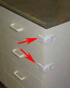 Latches for childproofing kitchen drawers
