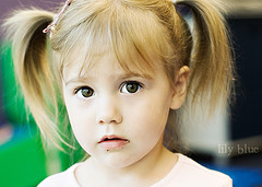 Little girl with hair tied in pigtails