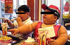 Overweight kids eating at McDonalds
